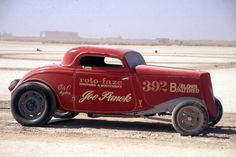 Powered by a supercharged Cadillac V12, Joe Panek's chopped '34 Ford has been a Southern California racing fixture for decades. Panek built the car in 1964 to promote his Roto-Faze distributors at the lakes, drags and on the salt. Here the coupe is pictured at a Muroc dry lakes reunion back in the 1990s.