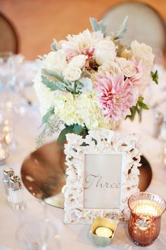 Pink and white wedding arrangements