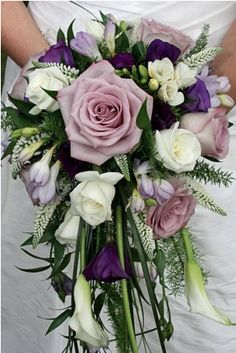 Cascade bouquet in whites, pinks and purple.