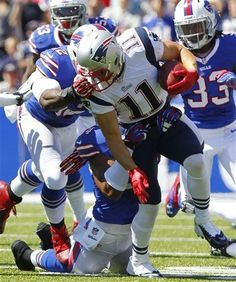 New England Patriots wide receiver Julian Edelman (11) is face-masked by Buffalo Bills linebacker Arthur Moats (52) during the first half of an NFL football game on Sunday, Sept. 8, 2013, in Orchard Park. (AP Photo/Bill Wippert)