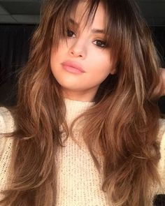 Of all the fringe inspiration, Selena Gomez's wispy bangs are the ultimate.. The look completely freshened up her her hair and frames her face perfectly.