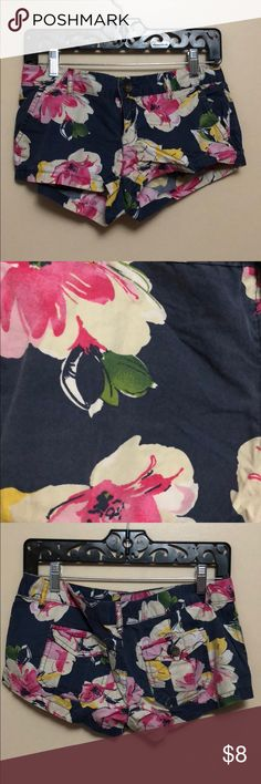 Aeropostale floral shorts Navy blue Aeropostale shorts with pink, white, green and yellow floral prints. Short shorts, barely worn. Very light weight. Aeropostale Shorts Jean Shorts