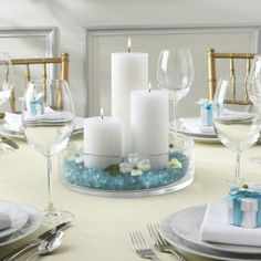 Simple Candle Center piece. Could use color sand or sea glass or sea shells