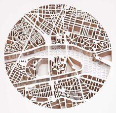 cut paper maps in layers