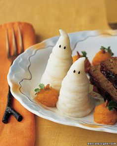 Haunt your guests with these adorable mashed potato ghosts. You'll need a pastry bag to get the shape just right and black sesame seeds for the eyes.