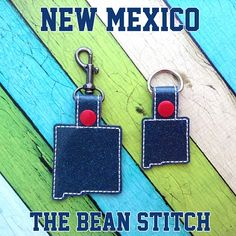 New Mexico - Includes TWO(2) Sizes!  #thebeanstitch #beanstitchers #TBS #ith #inthehoop #machineembroidery #felties #feltie #embroidery #digitaldownload #keyfobs #bagtag #diy #snaptab #snapbean #handmade #vinyl #felt #craft #etsy #shopsmall #embroiderygift #travel #everyday #design #multipurpose #state #NewMexico #keychain Kam Snaps, Glitter Vinyl, Tbs, Key Fobs, New Mexico, Machine Embroidery Designs, Free Design, Geek Stuff, Felt