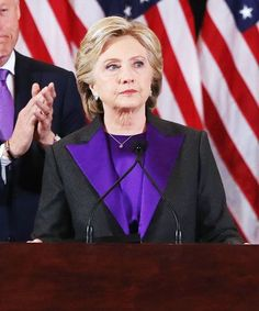 For her concession speech, Hillary Clinton stepped on stage in a dark grey suit with a bright satin purple lapel and shirt.