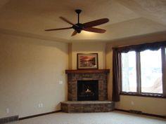 brick corner fireplaces with mantle | Schmidt Construction, Inc. > Fire Places