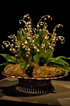 Pearls and diamond lilies of the valley in miniature golden basket by Peter Carl Fabergé (1846-1920)