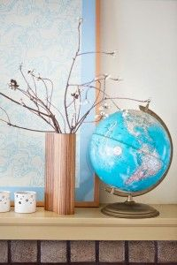 love the cool blue colour of this globe. well paired with the blue matted topo map behind.