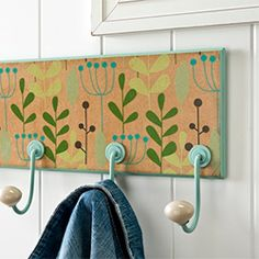 Use Mod Podge and wrapping paper to revamp a cheap coat rack.
