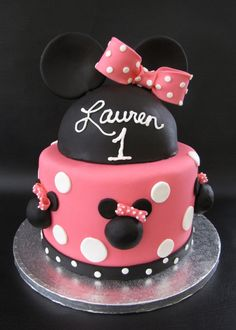 This cake has been done again and again and it's hard to get a lot originality out of it, but it's the small things, right?  Cake is Vanilla Bean cake with strawberry filling and covered in MMF.  All accents are made out of fondant as well.  The small Minnie Mouse heads are made out of rice cereal treats and covered in fondant.  The hat is made from a half ball pan.  TFL