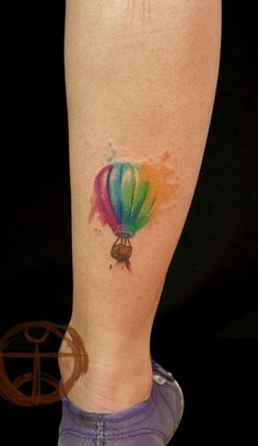 small watercolor air balloon tattoo