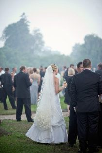 I adore her veil and how it is bustled up for the reception!- So smart!