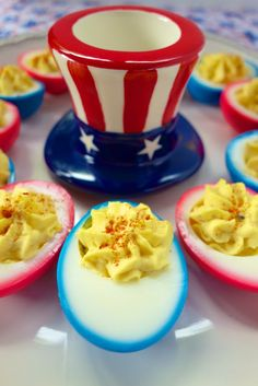 Patriotic Deviled Eggs: Just let hard-boiled eggs sit in a water/food-color mix for 2 hrs. Colorful outside. tasty as usual :D