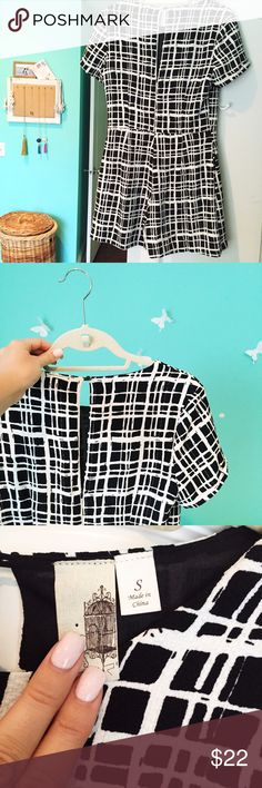 Francesca's romper Black & cream check print. Short sleeve skort (dress in the front, romper in the back) key hole top! Worn once. Stretchy material, super comfy Francesca's Collections Dresses Mini