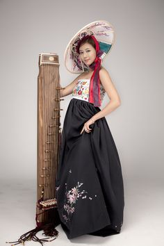 A hanbok, a hat, and a harp
