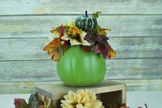 This Fall Pumpkin Centerpiece is absolutely perfect for your home this holiday season! The soft sage colored pumpkin adorned with all the warm, rich colors of fall will accent any room in your home pe