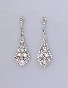 Bridal Chandelier Earrings in Vintage Style are encrusted with Sparkling Swarovski Crystals in these face flattering earrings. We have threaded ivory