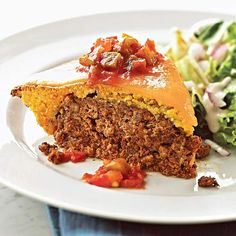 Enchilada Meat Loaf Perfectly sweet corn bread wraps up slightly spiced ground beef for an extra-tender meat loaf your family will love. Just spread the corn bread batter over the meat in a pie plate and bake. Then top with sharp cheddar cheese slices and serve with salsa.