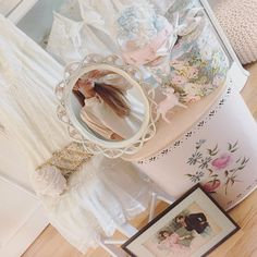 """""""went vintage shopping and came home with all these goodies! a tea gown, a clutch, a pink milk glass jar, a vanity mirror, a little reindeer decor piece,…"""""""