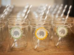 Old School: In between opening presents and playing a baby-themed game of Pictionary, offer the guests to sip drinks from vintage jars filled with gray-and-white striped paper straws and wrapped with sweet elephant tags.