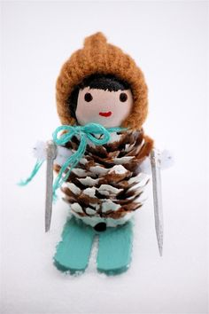 Cute little skiing pinecone people. I made these one year in high school for a couple of friends. :)