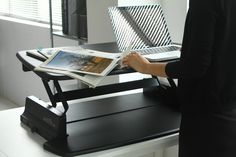 The surface of a VARIDESK desktop riser allows you to have paperwork alongside your laptop - http://uk.varidesk.com