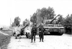 "Tiger I ""B12"" (probadly command vehicle) , belonging to 11.Kompanie/III.Abteilung/Panzer-Regiment ""Großdeutschland"" passes by abandoned Soviet ZiS-3 AT guns ,while 2 Panzergrenadiers of ""Großdeutschland"" Division stand in front of them ,Vilkaviški ,Lithuania ,August 1944 ___________________________________________ #history #militaryhistory #tank #warthunder #panzerschreck #ukraine #ussr #russia #wehrmacht #luftwaffe #kriegsmarine #ss #waffenss #award #medal #german #germany #deutsch…"