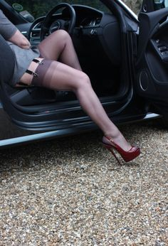 Incredible! Gorgeous legs in real stockings but just look at those shoes!! I normally despise platforms but these are no cheat! The pitch is absolutely extreme! Her feet and ankles look amazing.