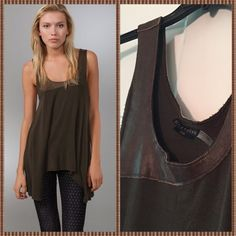 """Alice + Olivia Curved Hem Tank. Alice + Olivia Curved Hem Tank. This military green jersey tank features distressed 100% leather trim with laser-cut edges at the scoop neck. Unfinished edges at arm openings and at asymmetrical hem. 1.5"""" straps. Fabrication: 96% viscose/4% spandex. Alice + Olivia Tops Tank Tops"""