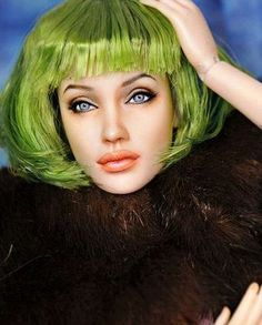 sybarite; angelina jolie.  Had to look twice.  Is this a doll!