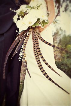 Bride's Dramatic & Unique Bouquet: White Phalaenopsis Orchids, Green Trailing Ivy & Other Greenery/Foliage + Gorgeous Pheasant Feathers ^^^^ Bouquet Bride, Feather Bouquet, Wedding Bouquets, Feather Art, Floral Wedding, Fall Wedding, Our Wedding, Dream Wedding, Pheasant Feathers