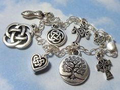 Celtic symbols silver charm bracelet - celtic knot, tree of life, celtic cross, heart, and goddess charms - free USA shipping.