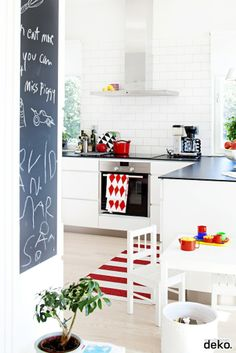 White kitchen, subway tile, red, pops of color