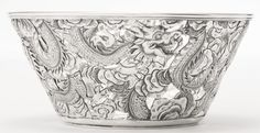 A SET OF SIX CHINESE EXPORT SILVER BOWLS, WANG HING, HONG KONG, CIRCA 1900 the bowls pierced and chased with dragons. Together with a set of six silver-gilt and enamel tea glass holders, pierced and enameled with birds and flowers, with pseudo Russian marks. 12 pieces. marked on bases diameter of bowls 5 in., height of cups 2 3/4 in.