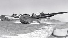 """Boeing 314 Flying Boats:  Pan Am's """"American Clipper"""" NC18606. Pan American Airways System - in the full livery at Waitemata Harbour, Auckland, December 7, 1940. © Whites Aviation / Alexander Turnbull Library Image WA-00323-G via P. Sheehan Collection - 1950-093. http://www.aussieairliners.org/scrapbook/boeing%20314/boeing314.html"""