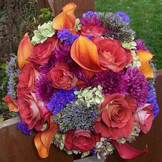 Editors' Picks: 30 Best Bouquets: Show Off with Contrast A playful contrast between warm orange calla lilies and cool purple chrysanthemums holds this colorful combination together. Statice, trachelium, hydrangeas, and roses round out the bouquet.  -- Photographer and floral designer Sandra Meyer