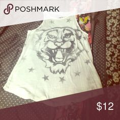 Tank Tiger with stars tank.                                              Bought for 20$ selling now for 10$.            Please ask questions before purchasing if needed.                                                                    Hope you enjoy my closet, happy shopping! PacSun Tops Tank Tops