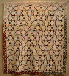 Hexagons and 9-patches at Tokyo 2012 by Luana Rubin, via Flickr.  Block is Jack's Chain.