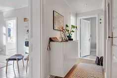 IKEA Hack - kitchen wall cabinets with marble top become hallway sideboard / entry table