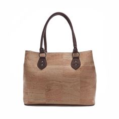 Elegant and roomy #handbag made of silky smooth #cork #leather. | #sustainable & #vegan. | CHF 180.00