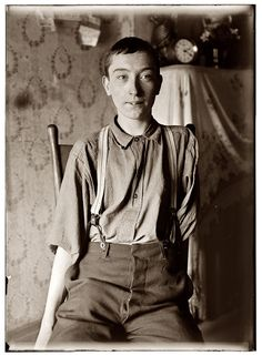 Harry McShane, of Cincinnati. 16 years old on June 29, 1908. Had his left arm pulled off near shoulder, and right leg broken through kneecap by being caught on belt of a machine in Spring Works factory in May 1908. Had been working there more than 2 years. Was on his feet for first time after the accident the day this photo was taken. He died in Cincinnati one month short of his 86th birthday. Despite his injuries and disability, he worked for the railroad for many years. by Lewis Wickes Hin...