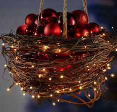 Hanging Basket with Christmas Lights and Baubles | Click Pic for 20 DIY Christmas Outdoor Decorations | DIY Front Porch Christmas Decorations on a Budget
