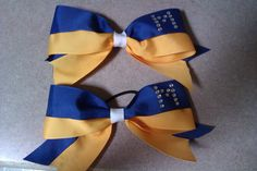 DIY Cheer Bows. The 2 colors right next to eachother is cute! :))