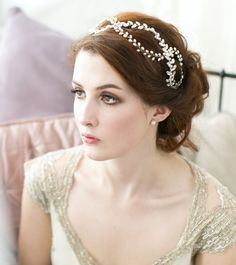 Strands of hand twisted freshwater pearls interlock with sparkly rhinestones to weave and wind through your hair in this gorgeous Laurel Headdress.  This tiara style headpiece is set on a delicate (and comfortable!) ribbon wrapped headband in either brown or blonde.  Handmade in the UK.  Photography by Hannah Mia.