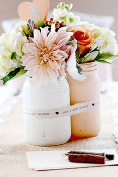Wedding Centerpiece. With peonies and roses to match the bouquet instead of the pictured flowers. Would be a great way to incorporate Anthony's mason jar preference and still look super classy