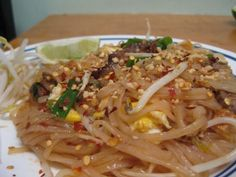 Yummy pad thai recipe - tofu, eggs, bean sprouts, meat, noodles, and delicious sauce!