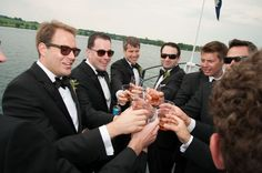 Groomsmen enjoying the cocktail hour on the boat ride