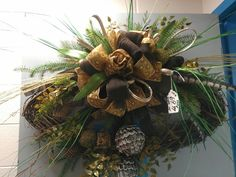 Winter Oval grapevine wreath, feathers, burlap ribbon